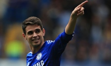 Chelsea's Oscar celebrates scoring against Aston Villa in the Premier League match