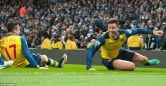 24D1C78100000578-2915617-Giroud_slides_in_jubilant_celebration_and_is_joined_by_Arsenal_t-m-51_1421602651509